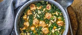 Hearty greens and meatball soup